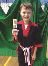 Deaf child in Taekwondo outfit