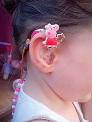Hearing aid decorated with Peppa Pig