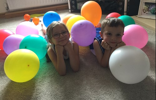 Siblings with balloons