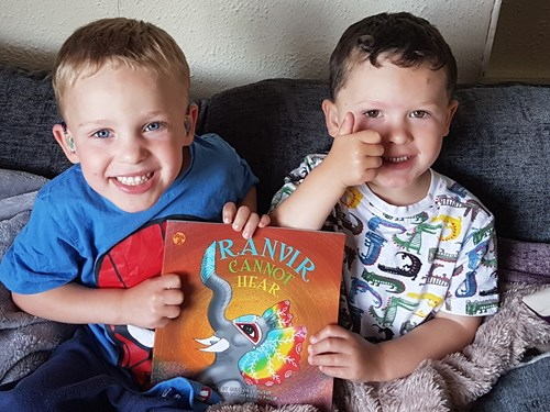 Deaf twins with Ranvir Cannot Hear book