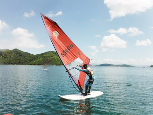 Deaf teenager windsurfing.
