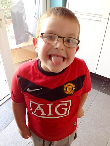 Deaf child sticking his tongue out