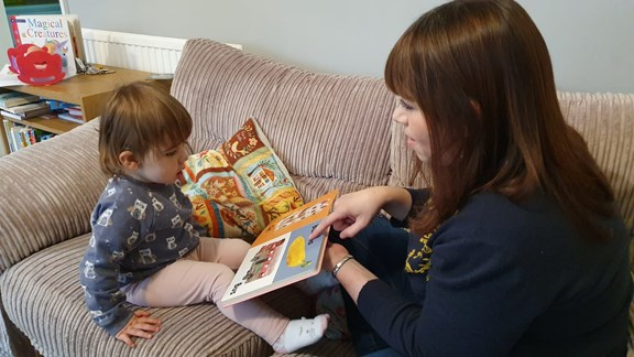 Mum reading to daughter